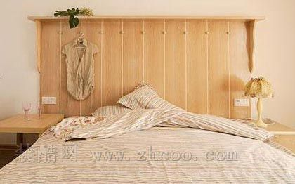 卧室背景墙装修效果图,橘红色的墙面设计也是卧室一大亮点.-卧室