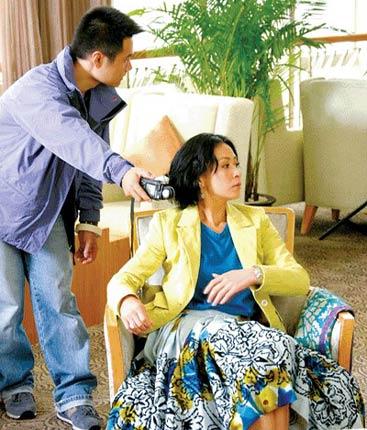 刘嘉玲上月来渝拍摄该楼盘的平面广告